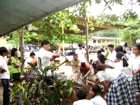 2008 Students filling plastic bottles with soil to set up container gardening
