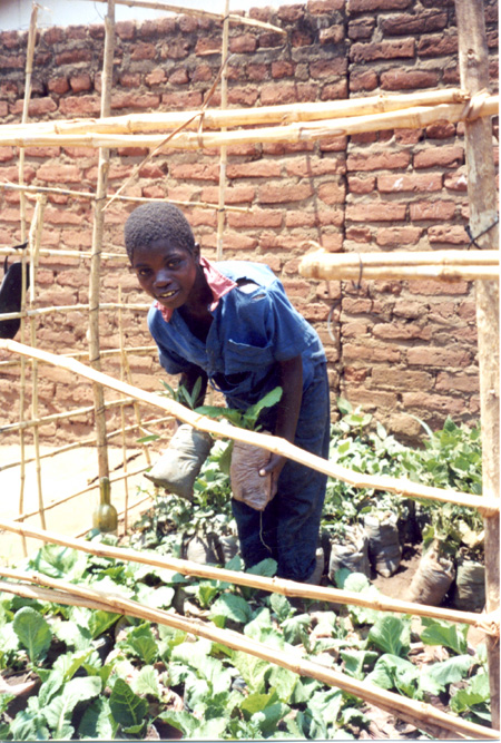 2009 - Etala is a member of the FOM Kids Club who learned the technique of container gardening.  Kids  love to do a lot of work in the garden at the projet site and later they will set up their own garden at home.
