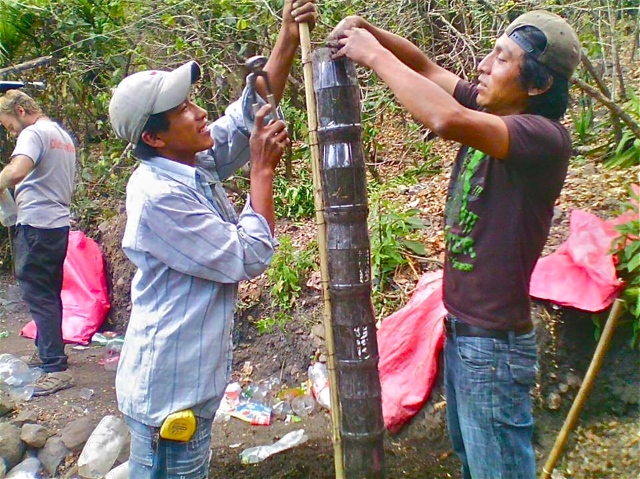 Local Guatemalans setting up a bottle tower (Photo Jay Jackson 2014-03)