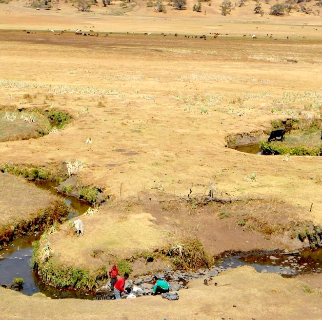 Children washing clothes in a meandering highland river in the dry season. Photo Credit: Daniel Van Rooijen/IWMI. - https://wle.cgiar.org/sites/default/files/images/stories/DSCN1934_0.JPG