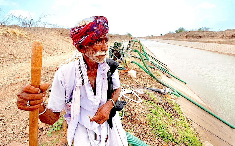 http://g9jzk5cmc71uxhvd44wsj7zyx.wpengine.netdna-cdn.com/wp-content/uploads/2015/12/Farmer-in-Gujarat-looks-on-as-irrigation-pumps-and-pipes-pull-water-from-the-canal-for-farms.jpg